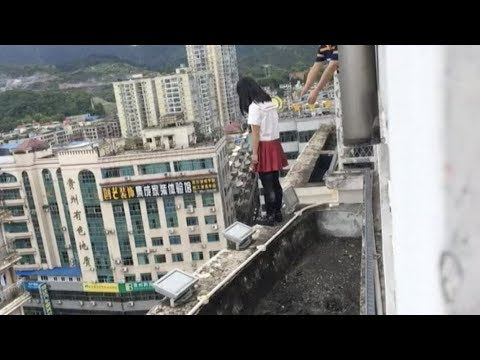 Teacher Saves Depressed Student from Leaping off Building in Guizhou