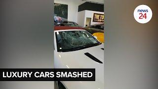 WATCH   Luxury car dealer's showroom trashed by gang of 40 men