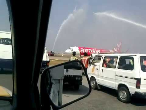 "AirAsia India""s first Airbus 320 VT-ATF MSN6015 gets water cannon salute upon arrival at Chennai"