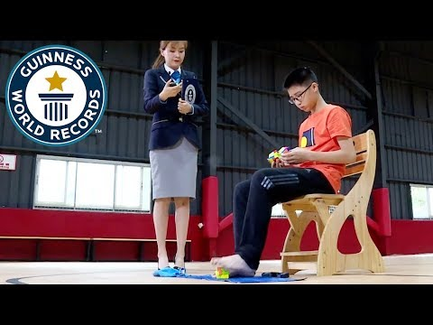 Rose - Teen Breaks Record For Solving 3 Rubik's Cubes- One with His Feet!!