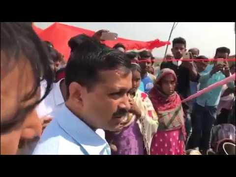 Delhi CM Arvind Kejriwal visiting the Okhla Jhuggi area where fire accident happened meeting public