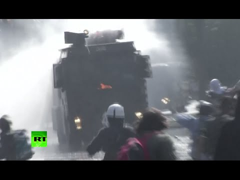 Molotov cocktails v water cannon: Chile student protest turns violent