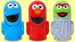 Sesame Street Tin Can Surprise Toys with Elmo, Cookie Monster, and Oscar the Grouch!