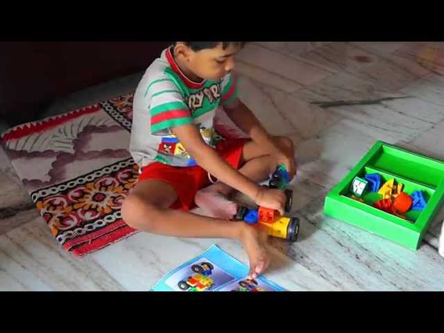 Arnav Playing With Nano Blocks