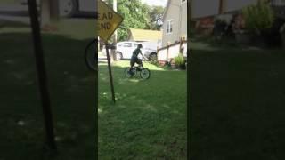Girl almost fall of bike .