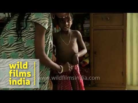 Mother Helps Son Get Ready For School In Assam