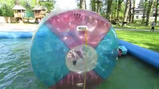 Funny kids play water cylinder in pool, Walec wodny w basenie dla dzieci