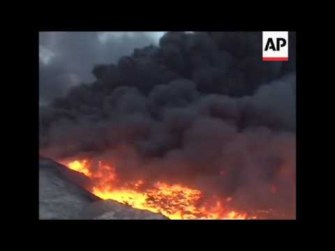Oil fires lit by IS group continue to burn