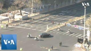 Motorcade Carrying N. Korea's Kim Jong Un Drives Through Beijing