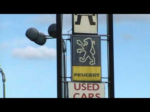 Peugeot car dealer sign in USA