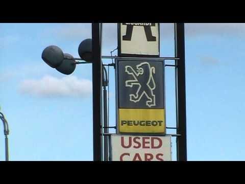 Peugeot Car Dealer Sign In USA