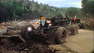 Civilian and military heavy equipment remove debris after floods in Rapid City. HD Stock Footage