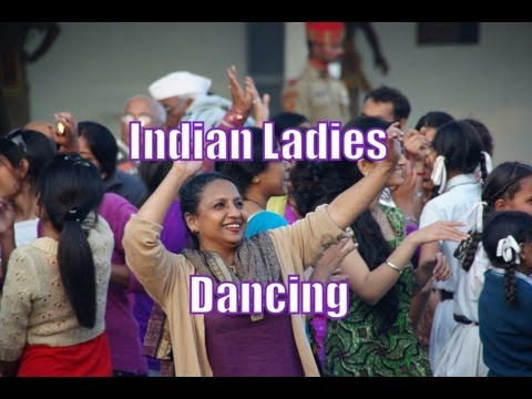 Indian Ladies dancing during ceremonial India Pakistan Border Closing Ceremony - Wagah, India