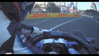George Russell pushes his car away from the Pit lane entry unaided