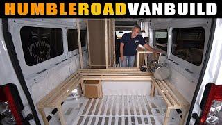 Massive storage & hidden shower found in this cardboard van build