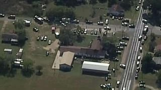 Families gather at community center after church shooting