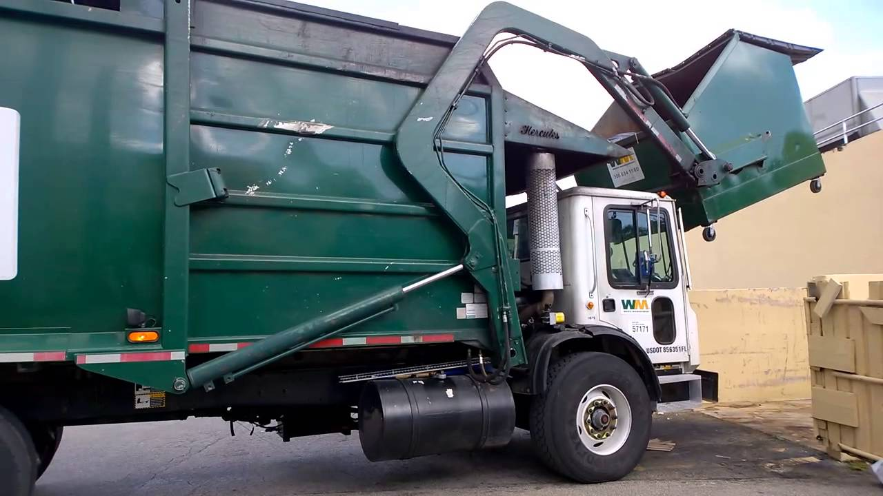 Garbage Truck Emptying A Dumpster Youtube
