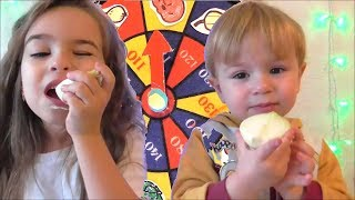 Spin the MYSTERY WHEEL CHALLENGE or how children try to eat unusual foods