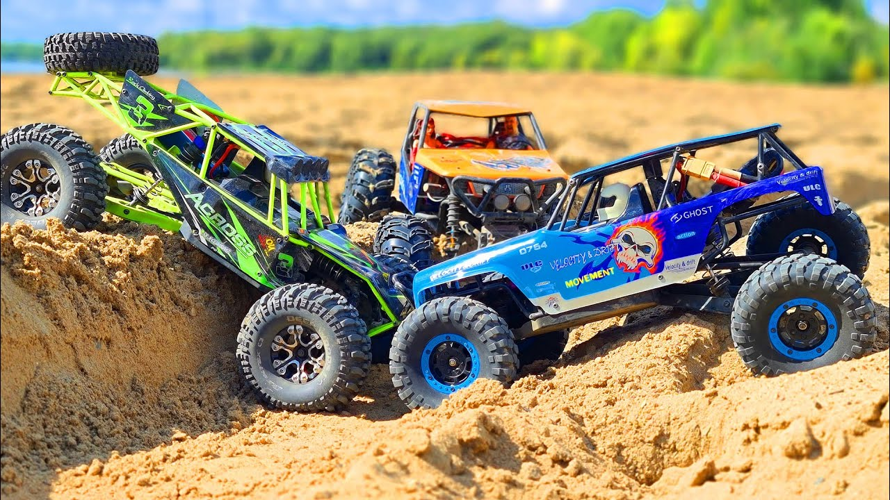 RC CARS Sand Storm Racing – 2 WlToys 10428 VS Axial Wraith