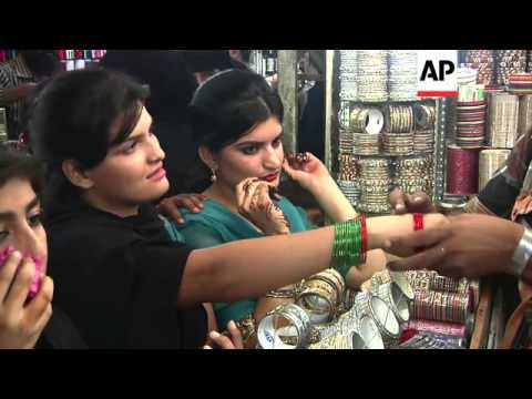 Shoppers throng markets in Karachi as people prepare for festival of Eid al-Fitr
