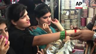 Shoppers throng markets in Karachi as people prepare for festival of Eid al-Fitr