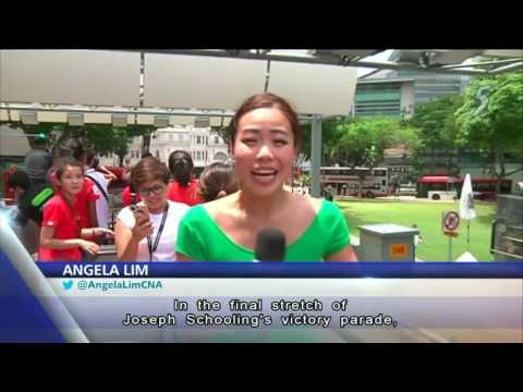 Thousands turn up to cheer Joseph Schooling during victory parade
