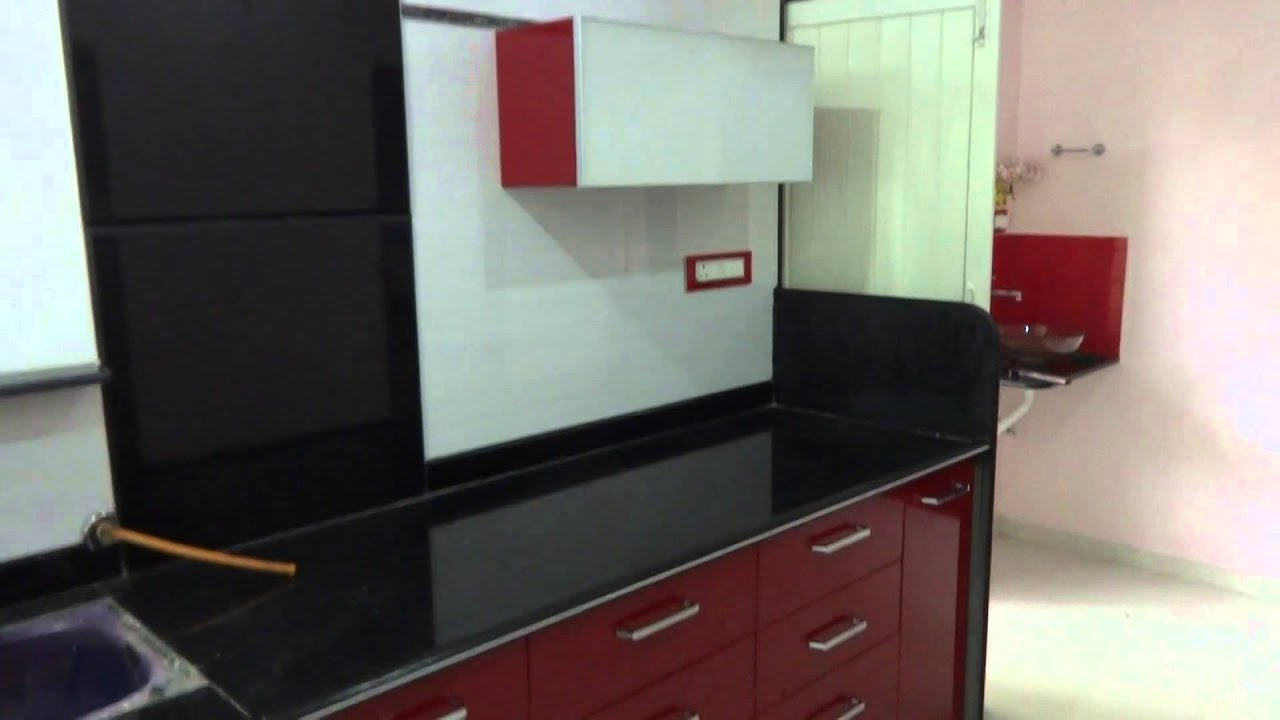 modular kitchen with red colour in baroda ritesh boghani 9824083905 ...