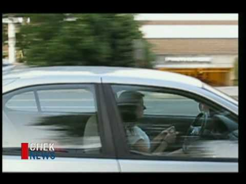 Caught on tape texting while driving.  CHEK NEWS