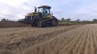 Hubert AH 7 Furrow plough working behind Challenger