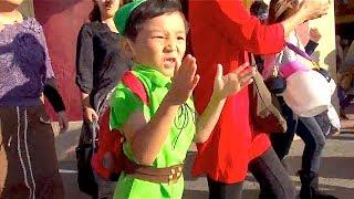 Kid is walking with the fancy dress of Peter Pan (Tokyo Disneysea)