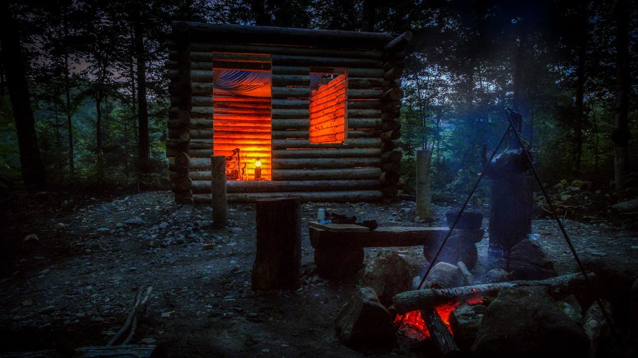 Primitive Log Cabin In The Forest Alone In The Wilderness With Hand