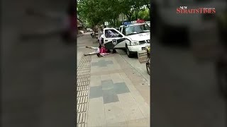 Video of cop slamming woman, baby to ground enrages China