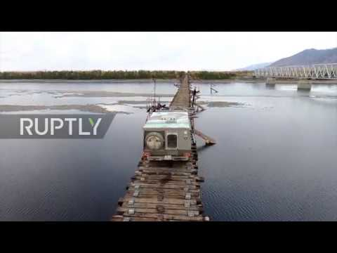 Dare you cross the world's scariest bridge? Russia's 500m of fear revealed