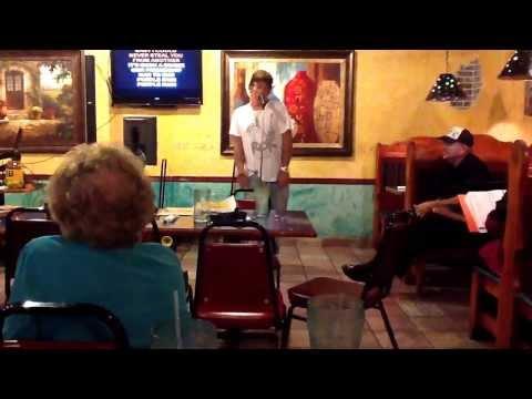 Karaoke host singing purple rain...hilarious!