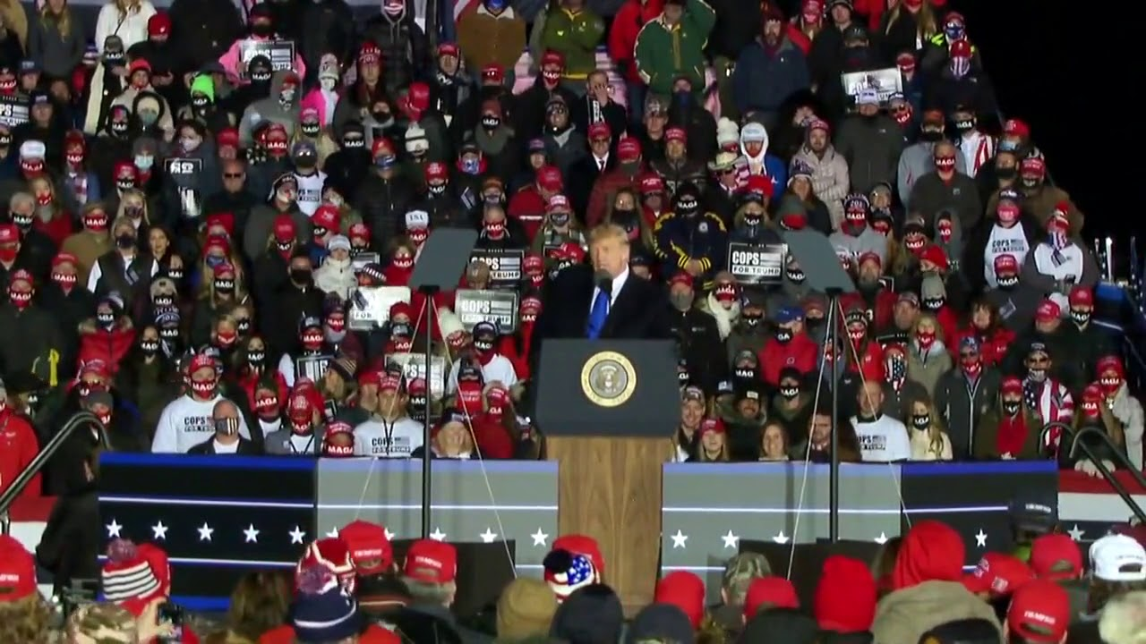 Supporters chant CNN sucks at President Trump's rally in Wisconsin