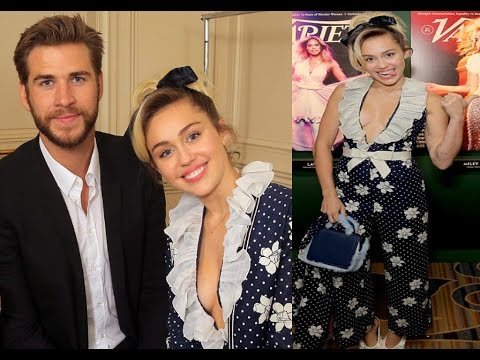 Miley Cyrus Wears Plunging Pantsuit While Snuggling With Liam Hemsworth - 2016
