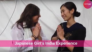 Indian girl talking to a Japanese girl  and sharing travel experiences