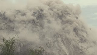 Paluweh Volcano Earthquakes, Rock Falls B-roll Stock Footage Screener Indonesia, 1920x1080 30p