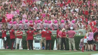 UGA fans stage 'pink out' to honor wife of Arkansas State coach who lost life to cancer