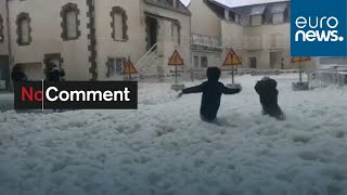 Sea foam floats onto streets of Brittany port town in the wake of Storm Ciara