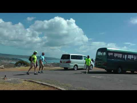 tourists and tour buses at the Blockhouse on Antigua, Antigua and Barbuda