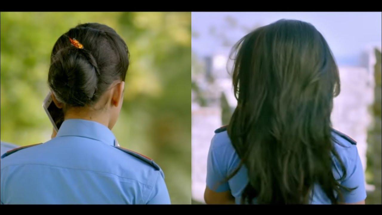 Policewoman Bundrop. A man hits her hairbun with a stick to open her hair. beautiful Bundrop. hair.