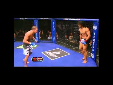 Wow! MMA Fighter Anthony Pettis Comes Off Cage W Amazing Kick To Guys Face   BooBooTV Com