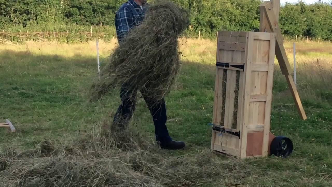hand-made hay bales with a box baler