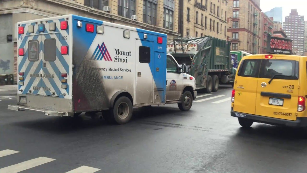 MOUNT SINAI WEST HOSPITAL EMS AMBULANCE RESPONDING ON COLUMBUS AVENUE ON  THE WEST SIDE OF MANHATTAN