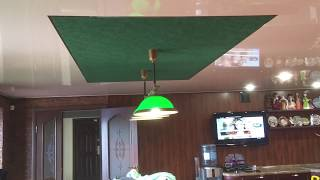 Замшевый натяжной потолок над бильярдом фактурой и цветом зеленого сукна и размером стола. Тольятти.