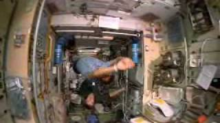 Shuttle Astronauts Weightless in Space