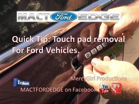 Removing the door touch pad on a Ford vehicle