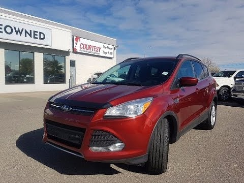 Sunset Metallic Ford Escape Se Courtesy Chrysler