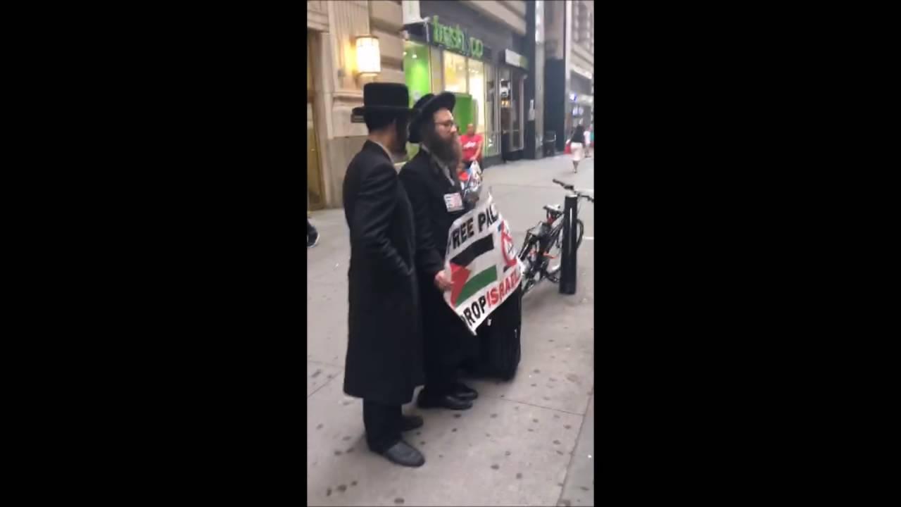 Chassidish Yungerman Deals With Neturei Karta In Manhattan Youtube